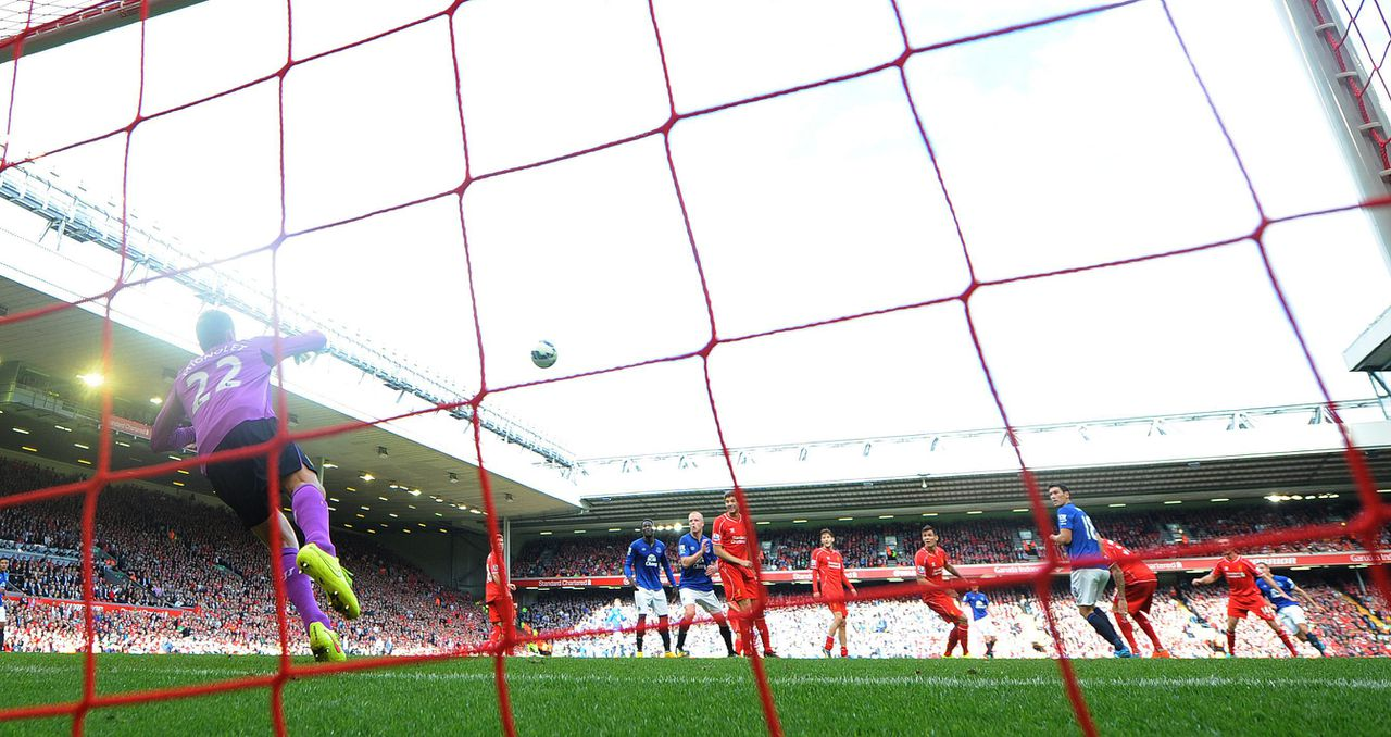 epa04420010 Everton's Phil Jagielka (R ) scores the equalising goal past Liverpool's Simon Mignolet (L ) during the English Premier League soccer match between Liverpool and Everton at Anfield in Liverpool, Britain, 28 September 2014. EPA/PETER POWELL DataCo terms and conditions apply http://www.epa.eu/files/Terms%20and%20Conditions/DataCo_Terms_and_Conditions.pdf