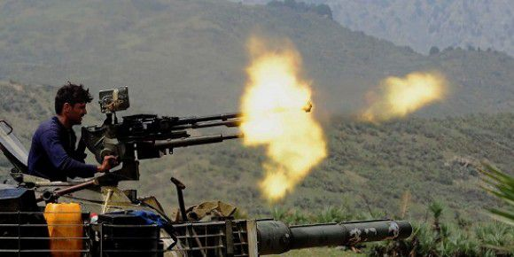 Caption: A Pakistani soldier fires a machine gun mounted on a tank in Manatu mountain at the central part of Kurram Agency, Pakistan's tribal belt bordering Afghanistan, during an operation against militants on July 10, 2011. The Pakistan Army said that it has taken over the control of the militants? hideouts at Manatu mountain in central Kurram Agency while three dozen militants were also killed during the operation. AFP PHOTO/A. MAJEED