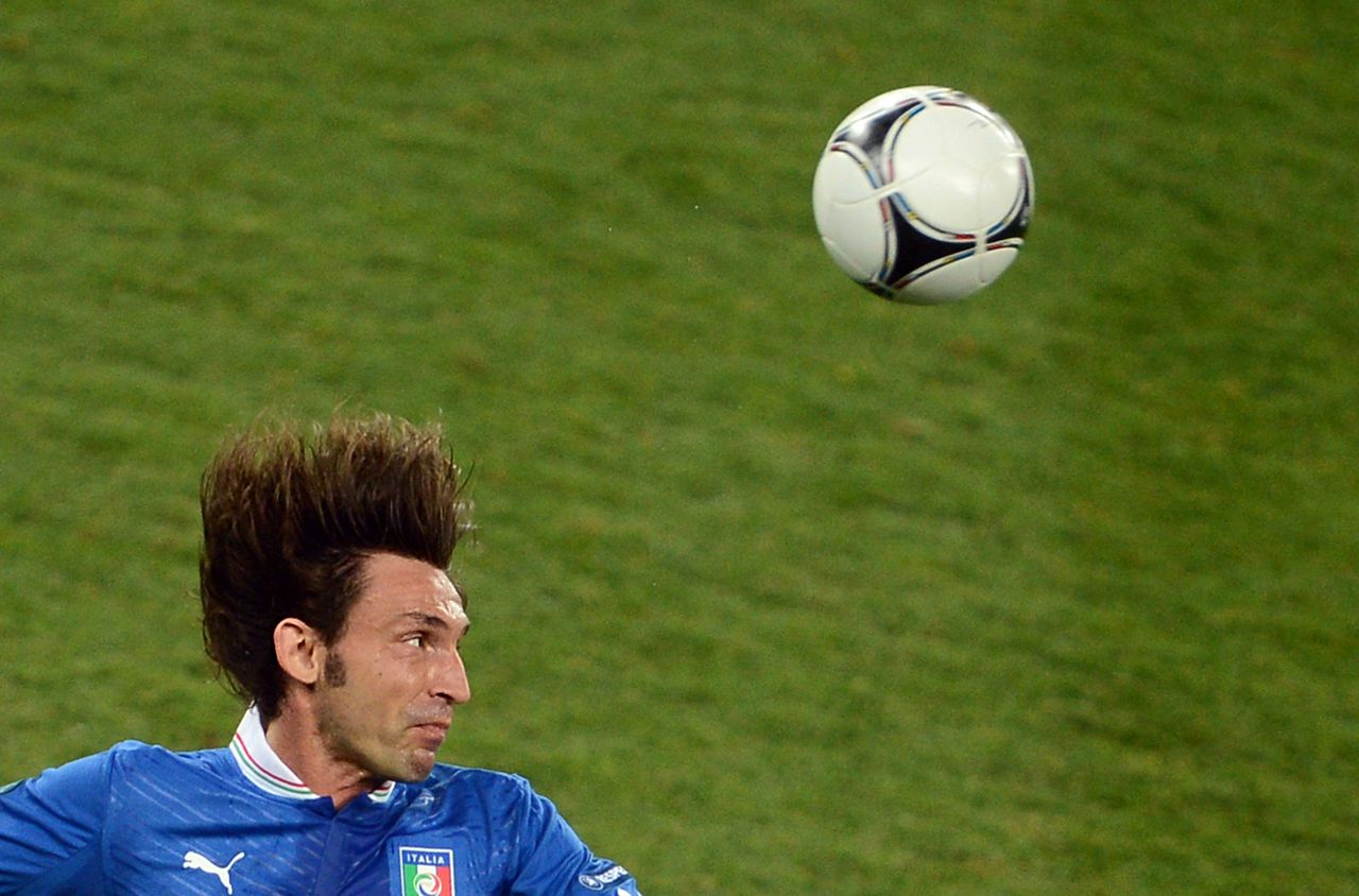 Italian midfielder Andrea Pirlo heads the ball during the Euro 2012 football championships quarter-final match England vs Italy on June 24, 2012 at the Olympic Stadium in Kiev. AFP PHOTO/ JEFF PACHOUD