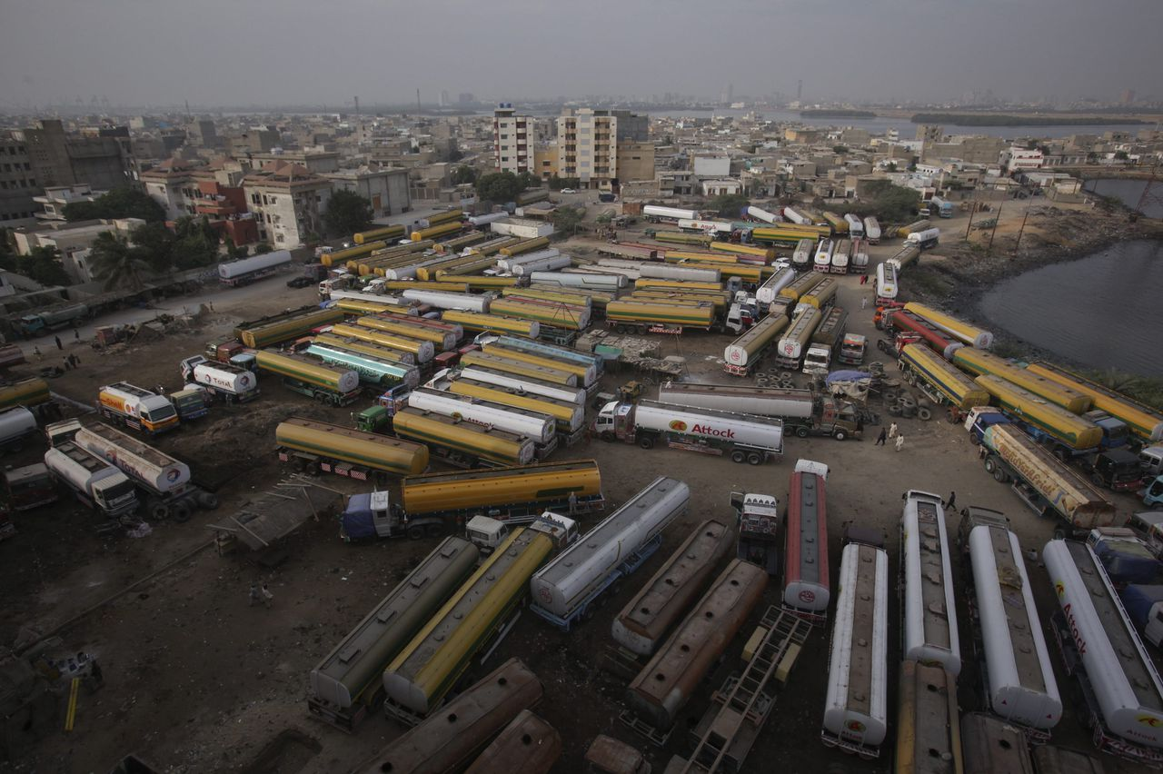 Fuel tankers, carrying fuel for NATO forces, are seen parked at a compound in Karachi November 29, 2011, after traffic was halted at the Pakistan-Afghanistan border Pakistan's government confirmed it would not attend an international conference on the future of Afghanistan in Bonn next week to protest against a NATO cross-border attack that killed two dozen Pakistani soldiers. REUTERS/Akhtar Soomro (PAKISTAN - Tags: CIVIL UNREST TRANSPORT MILITARY)