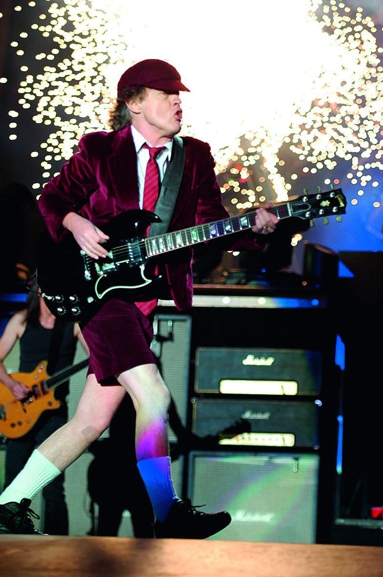 """TORONTO, ON - NOVEMBER 07: Angus Young of AC/DC performs live in concert during their """"Black Ice"""" Tour at the Rogers Centre on November 7, 2008 in Toronto, Canada. (Photo by George Pimentel/WireImage)"""