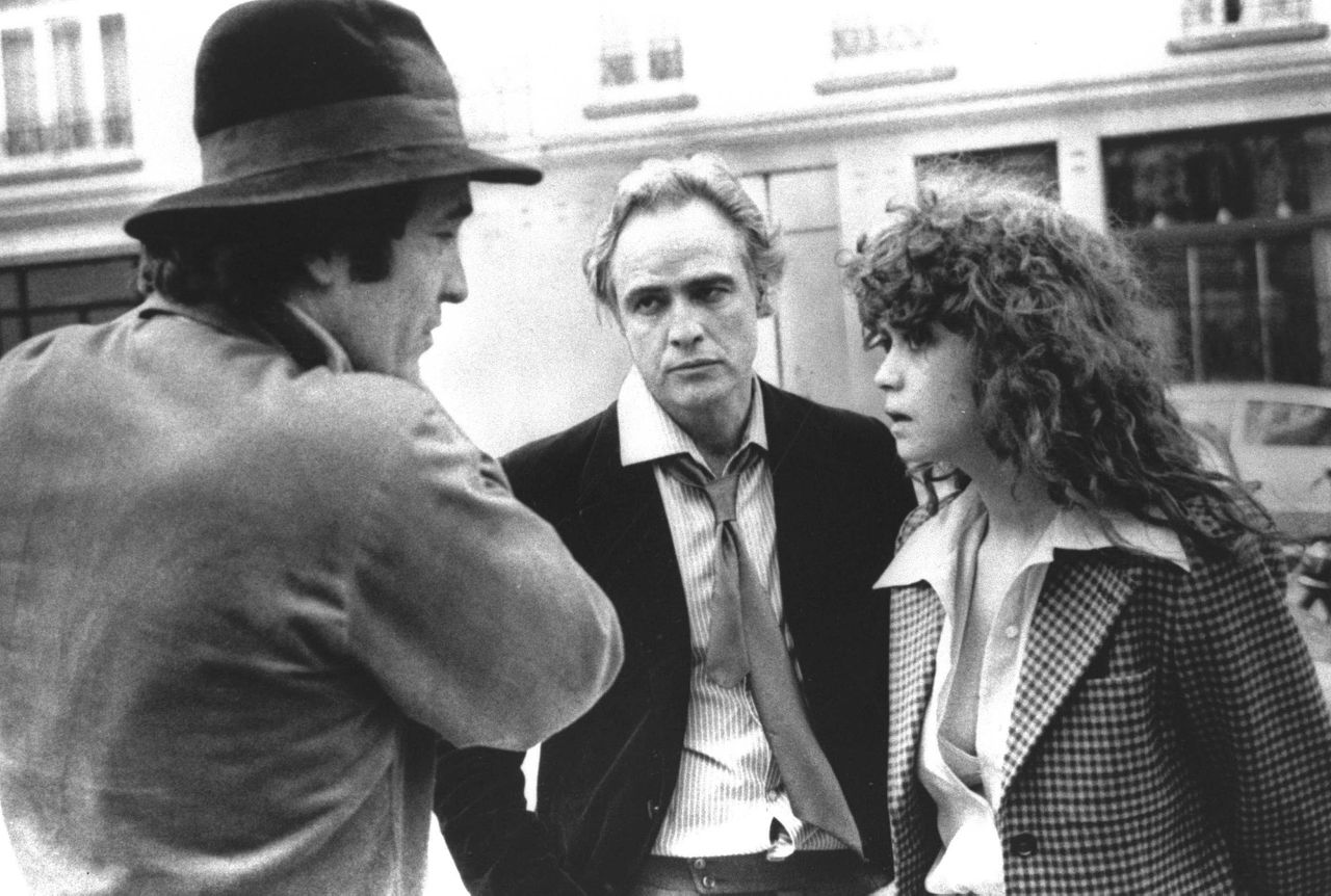 "FILE - In this 1972 file photo originally provided by United Artists, Director Bernardo Bertolucci, left, Marlon Brando and Maria Schneider are shown during the filing of ""The Last Tango in Paris."" A representative of the Act 1 agency said Schneider died in Paris on Thursday, Feb. 3, 2011, following a long illness. She was 58. (AP Photo/United Artists)"