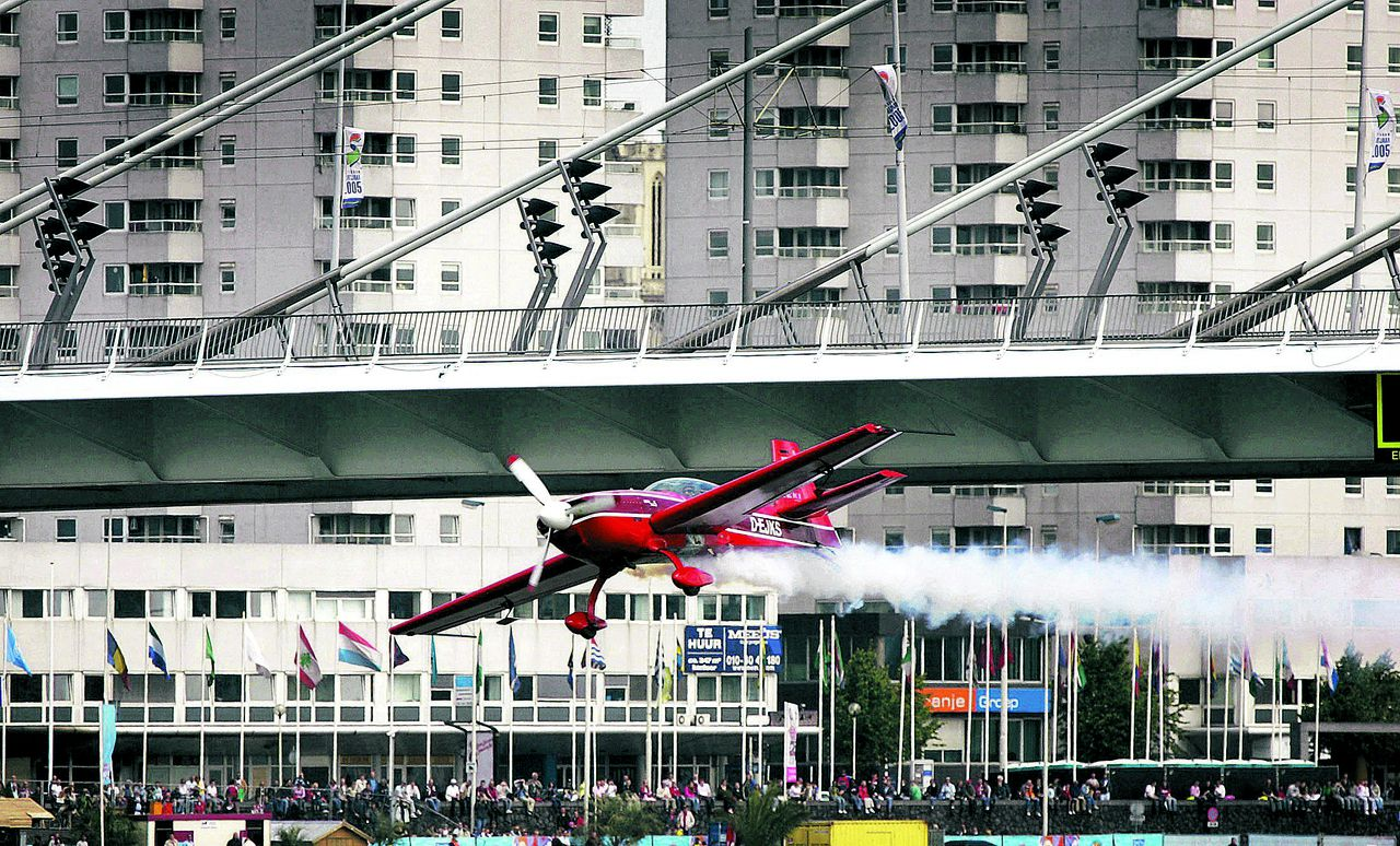 Klaus Schrodt from Germany flies his Extra 330 XS plane under the Erasmus Bridge during the Rotterdam Air Race in the centre of Rotterdam, The Netherlands, June 12, 2005.The Rotterdam Air Race is the second stop of the 2005 World series which features the world's finest acrobatic pilots and was launched two months ago in Abu Dhabi. The race will occur in Austria, Ireland, UK, Hungary and the U.S. over the next few months with a total of seven events. REUTERS/Michael Kooren