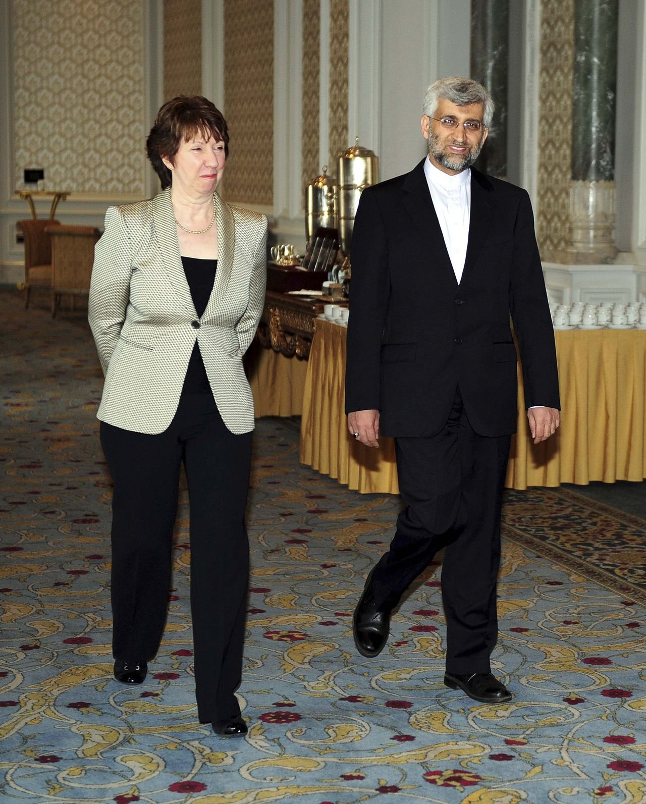 Iran's chief nuclear negotiator Saeed Jalili (R) and European Union foreign policy chief Catherine Ashton arrive for talks at the Ciragan Palace in Istanbul January 21, 2011. Iran gave no sign of making concessions to world powers trying to persuade it to rein in its nuclear programme at talks which began in Istanbul on Friday. REUTERS/Salih Zeki Fazlioglu/Anatolian/Pool (TURKEY - Tags: POLITICS) THIS IMAGE HAS BEEN SUPPLIED BY A THIRD PARTY. IT IS DISTRIBUTED, EXACTLY AS RECEIVED BY REUTERS, AS A SERVICE TO CLIENTS