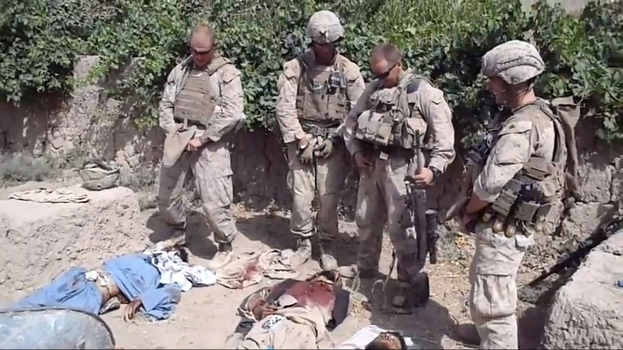 EDITOR'S NOTE: REUTERS CANNOT INDEPENDENTLY VERIFY CONTENT OF THE VIDEO FROM WHICH THIS STILL IMAGE WAS TAKEN. VISUAL COVERAGE OF SCENES OF INJURY OR DEATH A still image taken January 11, 2012 from an undated YouTube video shows what is believed to be U.S. Marines urinating on the bodies of dead Taliban soldiers in Afghanistan. The U.S. Marine Corps said on Wednesday it would investigate a video showing what appear to be American forces in Afghanistan urinating on the bodies of dead Taliban fighters. REUTERS/YouTube (AFGHANISTAN - Tags: MILITARY) NO SALES. NO ARCHIVES. FOR EDITORIAL USE ONLY. NOT FOR SALE FOR MARKETING OR ADVERTISING CAMPAIGNS. THIS IMAGE HAS BEEN SUPPLIED BY A THIRD PARTY. IT IS DISTRIBUTED, EXACTLY AS RECEIVED BY REUTERS, AS A SERVICE TO CLIENTS