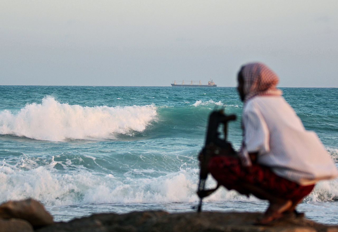 TO GO WITH STORY BY MICHEL MOUTOT (FILES) A photo taken on January 4, 2010 shows an armed Somali pirate keeping vigil on the coastline near Hobyo, northeastern Somalia, while the Greek cargo ship, MV Filitsa, is anchored just off the shore, held by pirates since being captured on November 10, 2009. AFP PHOTO/ MOHAMED DAHIR