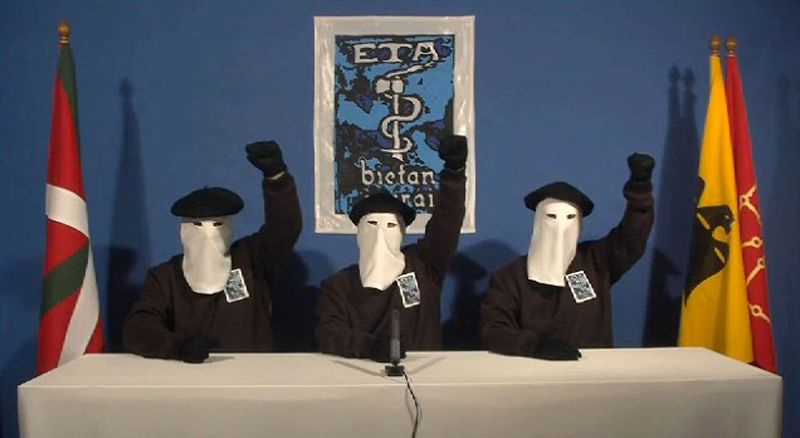 """RESTRICTED TO EDITORIAL USE - NO MARKETING NO ADVERTISING CAMPAIGNS - DISTRIBUTED AS A SERVICE TO CLIENTS A screen capture made on January 10, 2011 from an ETA video shows 3 members of the Armed Basque separatists ETA raising their fist after announcing today a permanent, verifiable ceasefire after more than 40 years of bloodshed in their fight for a homeland independent of Spain. """"ETA has decided to declare a permanent and general ceasefire which will be verifiable by the international community,"""" it said in a statement distributed to media in Basque, Spanish and English. AFP PHOTO/ HO"""
