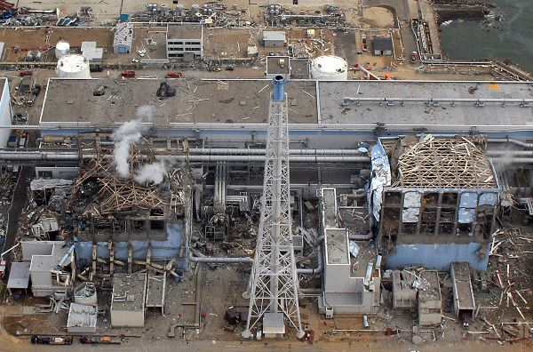 "----EDITORS NOTE----- RESTRICTED TO EDITORIAL USE - MANDATORY CREDIT ""AFP PHOTO / HO / AIR PHOTO SERVICE"" - NO MARKETING NO ADVERTISING CAMPAIGNS - DISTRIBUTED AS A SERVICE TO CLIENTS (FILES) This file picture taken by an unmanned aerial vehicle (UAV) of Air Photo Service on March 20, 2011 shows the stricken Tokyo Electric Power Company (TEPCO) Fukushima Dai-Ichi (No.1) nuclear power plant reactor number three (L) and four (R), with smoke rising from number three at Okuma town in Fukushima prefecture. Japan upgraded its nuclear emergency to a maximum seven on an international scale of atomic crises on April 12, 2011, the first time the highest ranking has been invoked since the Chernobyl disaster in 1986. AFP PHOTO / HO / FILES / AIR PHOTO SERVICE"