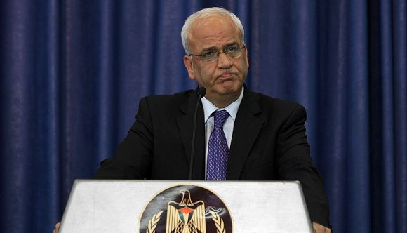 "Senior Palestinian negotiator Saeb Erekat addresses the media in the West Bank city of Ramallah after US President Barack Obama's Middle East speech on May 19, 2011, announcing that president Mahmud Abbas has called an ""urgent"" meeting of the Palestinian leadership to discuss the US stand. AFP PHOTO/ABBAS MOMANI"