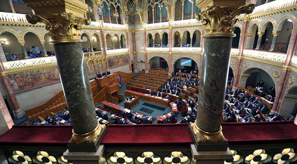 Caption: A general view of the upper chamber hall of the Parliament taken as representatives of the Hungarian Parliament vote in Budapest on December 30, 2011Hungary's parliament adopted on Friday a reform of the central bank that critics say increases the government's influence over monetary policy. Ignoring international criticism of the measure, lawmakers approved by a vote of 293-4 the law which led the EU and IMF to walk out of talks earlier this month on a possible bailout for Hungary worth 15-20 billion euros ($20-25 billion). AFP PHOTO / ATTILA KISBENEDEK