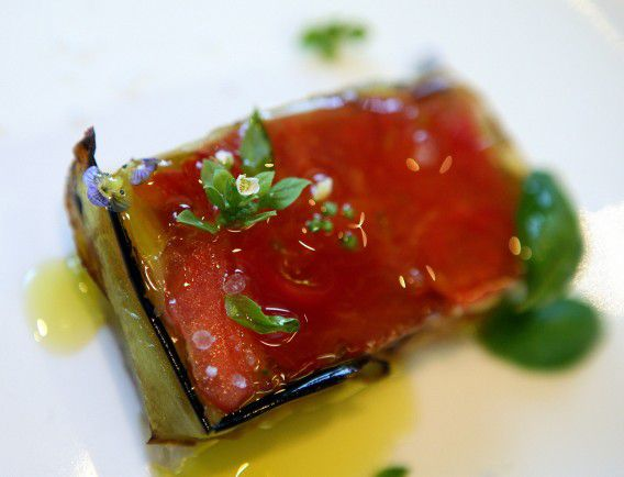 A starter plate of composta di pomodoro (pastry with tomato conserve) is seen at chef Nadia Santini's Dal Pescatore restaurant in the northern Italian town of Canneto Sull'Oglio May 4, 2006. Santini is one of three female chefs of a total of five cooks in Italy who have won the coveted Michelin three-star award. Italy has 226 Michelin-starred chefs and 60 are women -- the highest number in any European country. Picture taken May 4, 2006. To match feature Food-Italy-Women. REUTERS/Daniele La Monaca