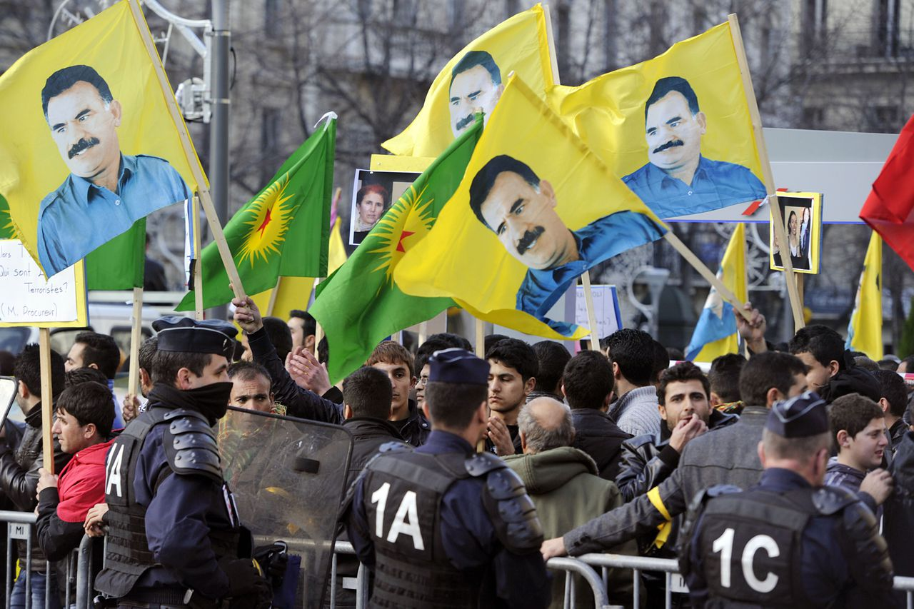 Hundreds of people of Kurdish origin wave portraits of jailed Kurdish rebel leader Abdullah Ocalan during a demonstration on January 10, 2013 in central Marseille following the killing of three Kurdish women activists in Paris. A co-founder of the Kurdistan Workers' Party (PKK) and two other militants were found shot dead on January 10 in Paris, a day after Turkey and the jailed leader of the banned group were reported to have agreed on a peace plan to end a three-decade-old insurgency. AFP PHOTO / BORIS HORVAT