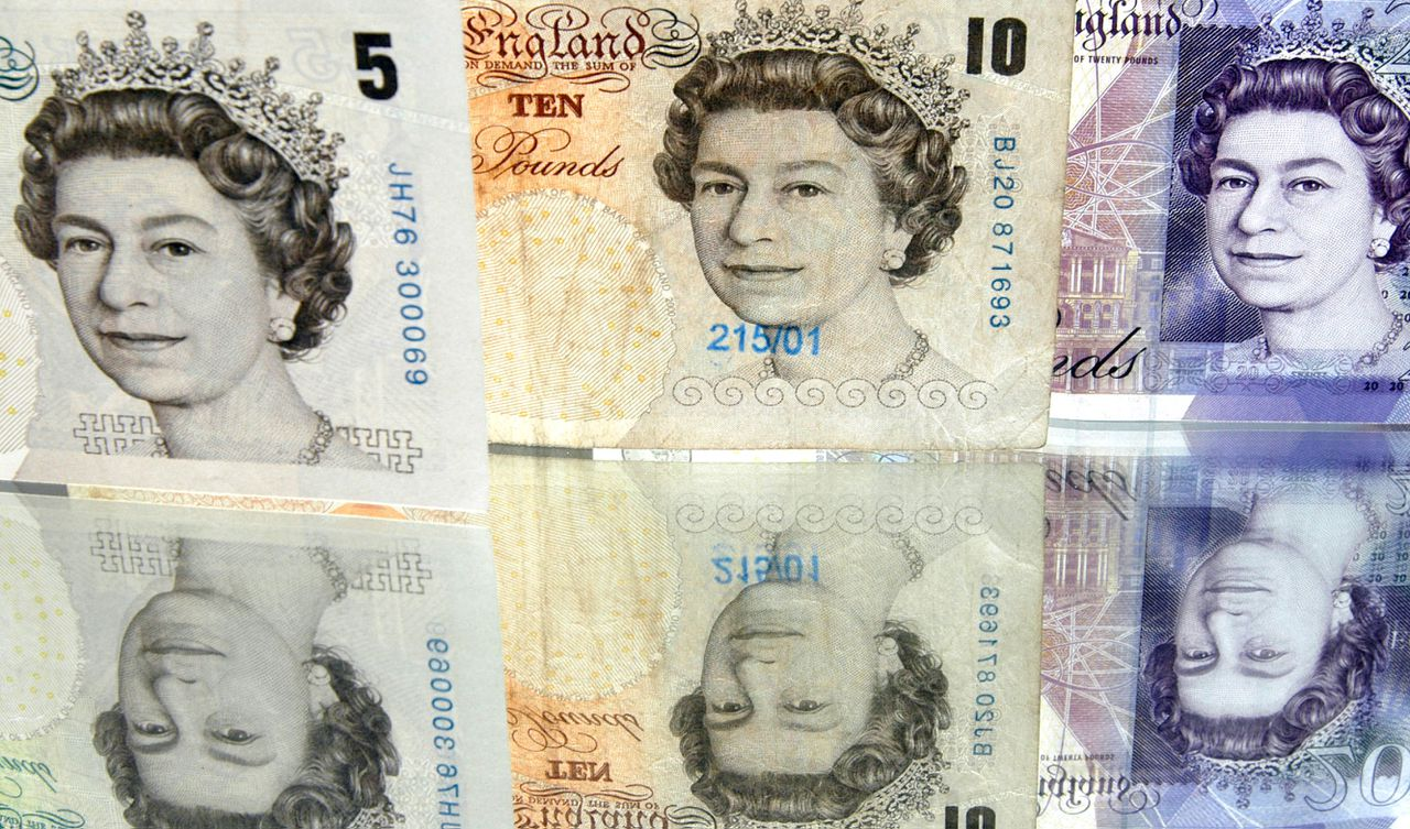 Britain's Queen Elizabeth II is pictured on British five, ten and twenty pound notes, arranged for a photograph in Paris, France, on Sunday, Oct. 28, 2007. The pound rose to a 26-year high against the dollar on speculation the Bank of England will keep interest rates at a six-year high while the Federal Reserve cuts borrowing costs tomorrow. Photographer: Alastair Miller/Bloomberg News