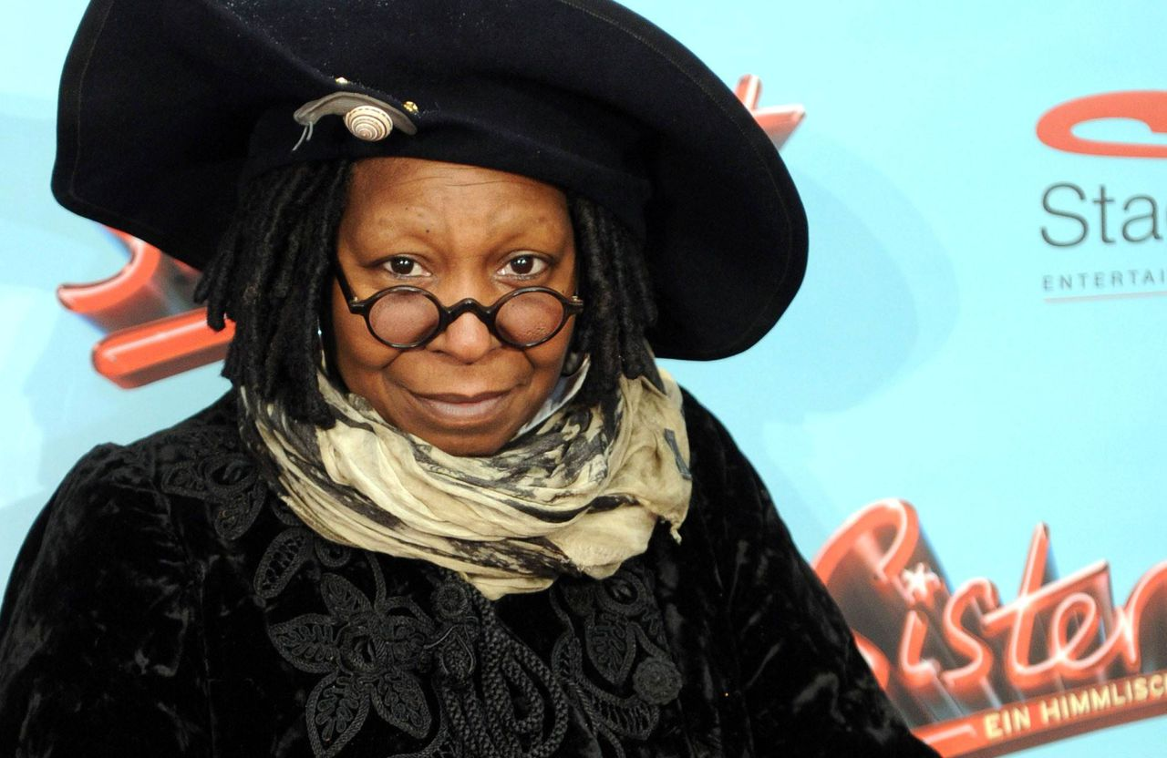 """US actress Whoopi Goldberg poses before the premiere of the musical """"Sister Act"""" on December 2, 2010 in Hamburg, northern Germany. AFP PHOTO ANGELIKA WARMUTH GERMANY OUT"""