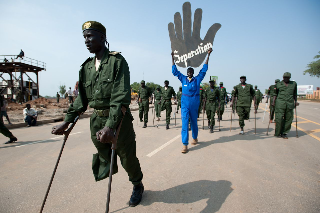 Injured war veterens march during a military parade rehearsal in Juba, South Sudan on July 5, 2011, four days prior to South Sudan officially declaring independence from Sudan after 21 years of war. AFP PHOTO/PHIL MOORE