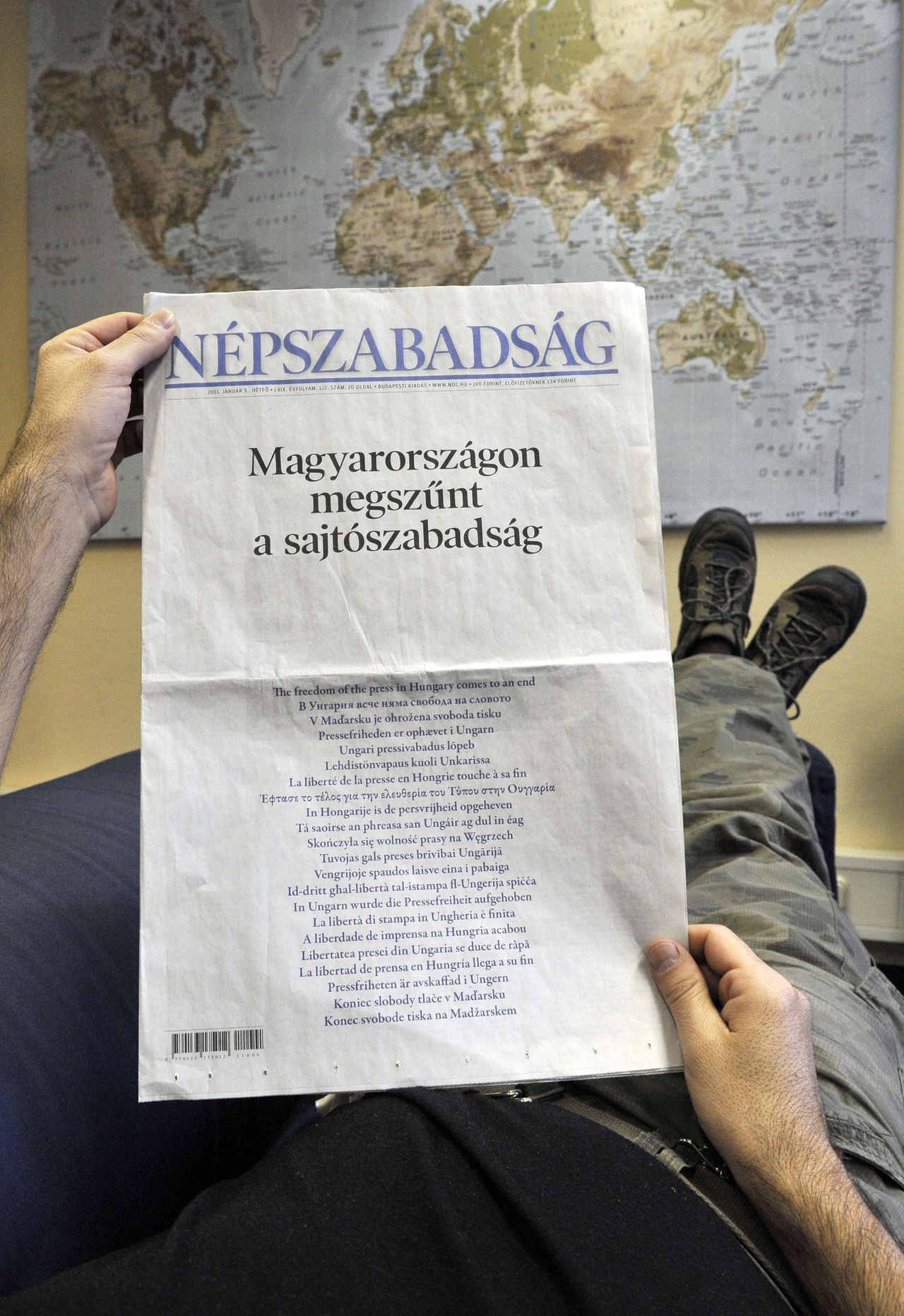 """A photo taken on January 3, 2011 in Budapest shows the front page of Hungarian daily Nepszabadsag. Two major Hungarian newspapers mourned what they saw as the end of press freedom today following the enactment of a controversial new media law, just as Budapest assumed the EU presidency. """"The freedom of the press in Hungary comes to an end,"""" the largest-circulation daily Nepszabadsag plastered on its front page in Hungarian, followed by the same sentence in every official language of the 27-member European Union. AFP PHOTO / ATTILA KISBENEDEK"""