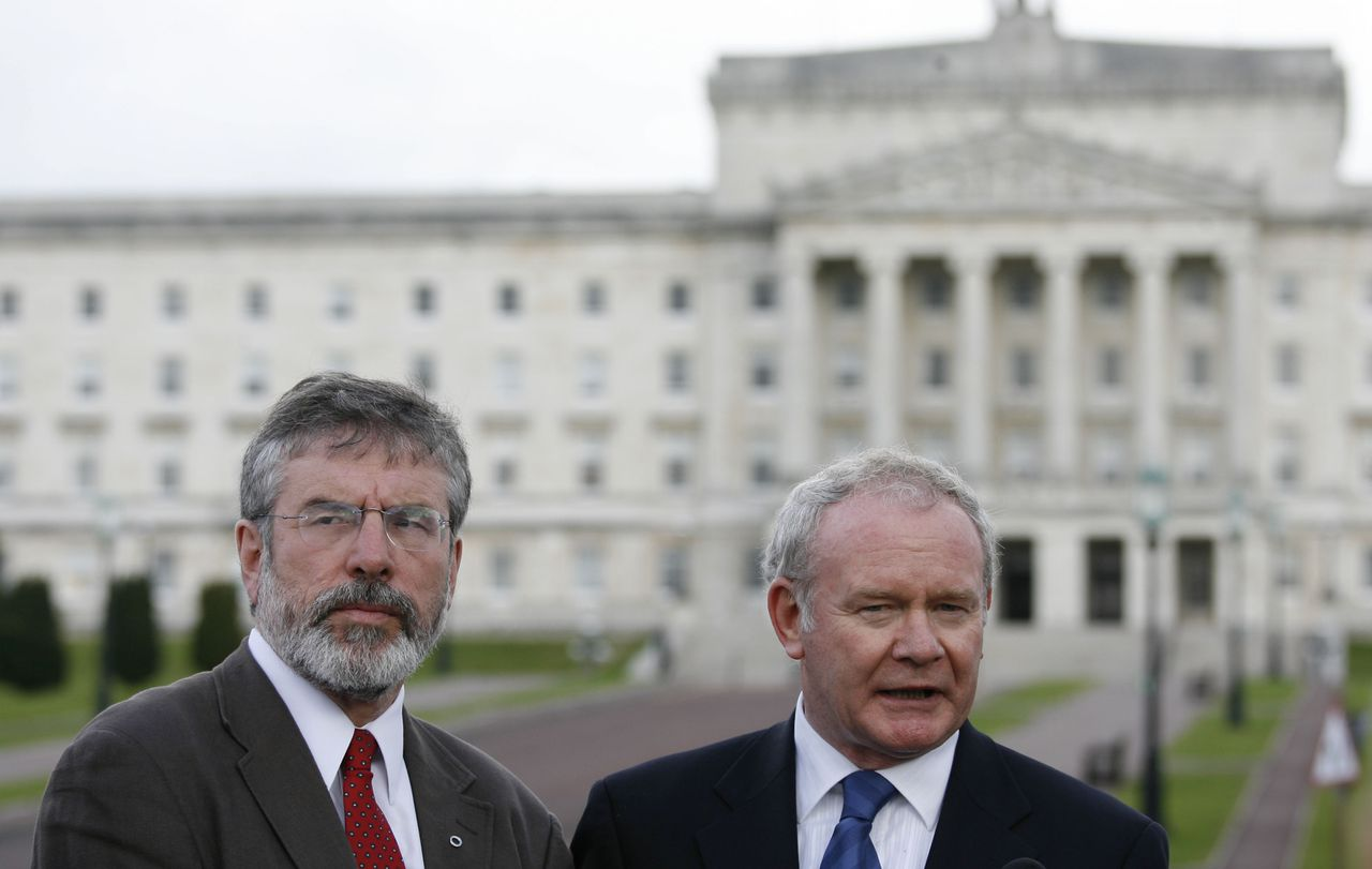 Sinn Fein President Gerry Adams, left, and Deputy First Minister Martin McGuinness, right, speak to the media outside Parliament Buildings, in Belfast, Northern Ireland, Monday, Oct. 5, 2009. British Prime Minister Gordon Brown traveled to Belfast to hold talks with political leaders on Monday to confront a deadlock over control of the police and the court system, which is threatening Northern Ireland's Catholic-Protestant government. (AP Photo/Peter Morrison)