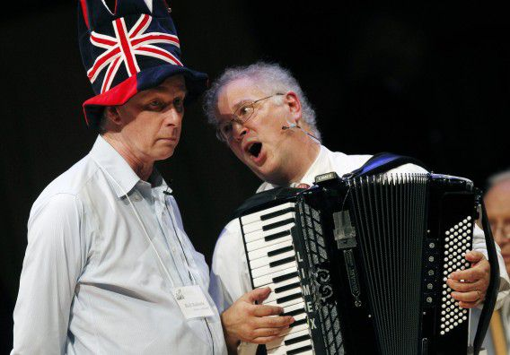 Nobel Laureate Rich Roberts (Medicine 1993), left, performs a song with Dr. Thomas Michel during the 21st annual Ig Nobel Awards ceremony at Harvard University in Cambridge, Mass., Thursday, Sept. 29, 2011. (AP Photo/Michael Dwyer)