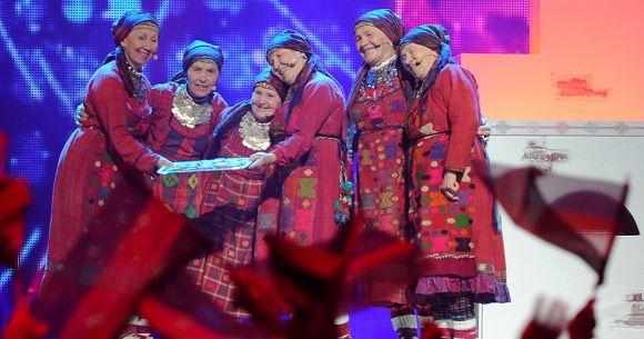 "Caption: Russia's group ""Buranovskiye Babushki"" (Buranovo Grannies) performs during the Grand Final of the Eurovision 2012 song contest in the Azerbaijan's capital Baku, early on May 27, 2012. AFP PHOTO / VYACHESLAV OSELEDKO"