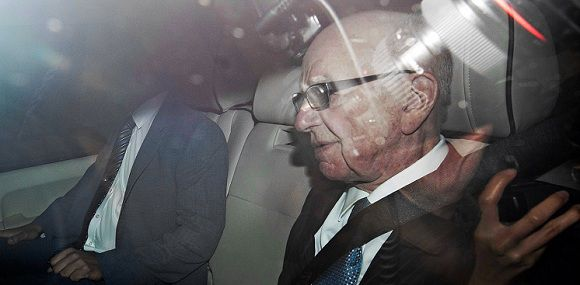 News Corporation Chief Rupert Murdoch (R) leaves his London home in a car with tinted windows on July 19, 2011. Media tycoon Rupert Murdoch, son James and former top aide Rebekah Brooks on Tuesday faced a dramatic showdown with British lawmakers over the phone-hacking scandal which has enraged the nation. The under-fire trio were to appear before a parliamentary committee to break their silence over the escalating crisis which on Monday claimed the scalp of a second police chief. AFP PHOTO / Ki Price