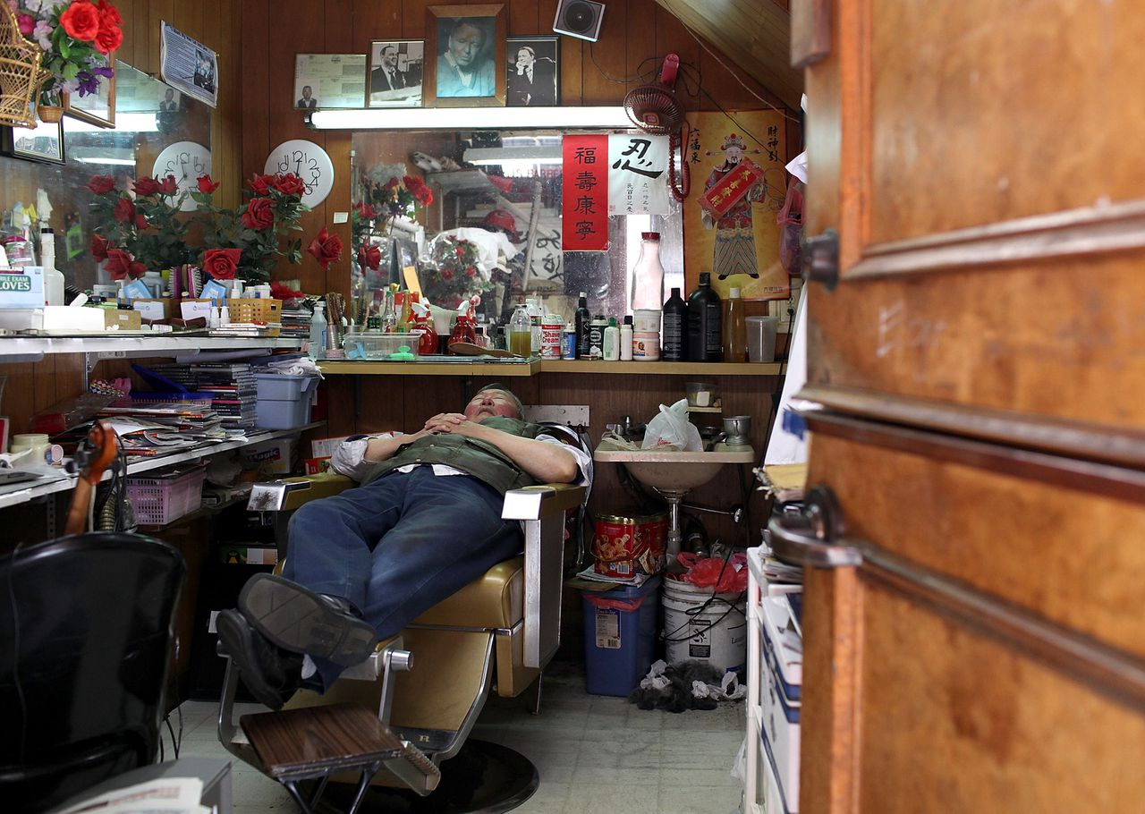 SAN FRANCISCO, CA - JUNE 19: A barber takes a nap on his chair inside his barber shop on June 19, 2012 in San Francisco, California. According to a study released today by the Pew Research Center, Asians have passed Hispanics to become the largest group of new immigrants to the United States, bringing the population of Asians to a record 18.2 million. An estimated 430,000 Asians immigrants, both legal and illegal, immigrated to the U.S. in 2010, compared with 370,000 Hispanics. In 2007, close to 390,000 Asians immigrated compared to 540,000 Hispanics. Justin Sullivan/Getty Images/AFP == FOR NEWSPAPERS, INTERNET, TELCOS & TELEVISION USE ONLY ==