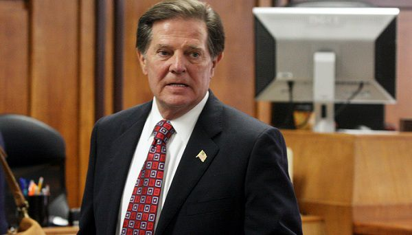Former House Majority Leader Tom DeLay waits for his sentencing decision at the Travis Co. Courthouse in Austin, Texas on Monday, Jan. 10, 2011 following his Nov. 24 conviction on charges of money laundering and conspiracy to commit money laundering in a scheme to illegally funnel corporate money to Texas candidates in 2002.(AP Photo/Jack Plunkett)