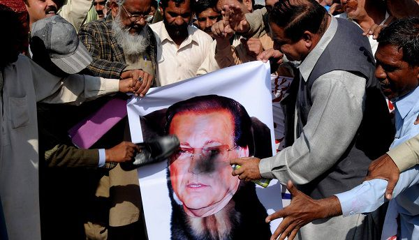 Protesters blacken and beat a poster of governor of Punjab's province Salman Taseer during a rally to condemn the Pakistani Christian woman Asia Bibi in Multan, Pakistan on Thursday, Nov. 25, 2010. Pakistan's president will not immediately pardon the Christian woman sentenced to die for insulting Islam but may do so later if an appeals court delays her case too long, an official said. (AP Photo/Khalid Tanveer)