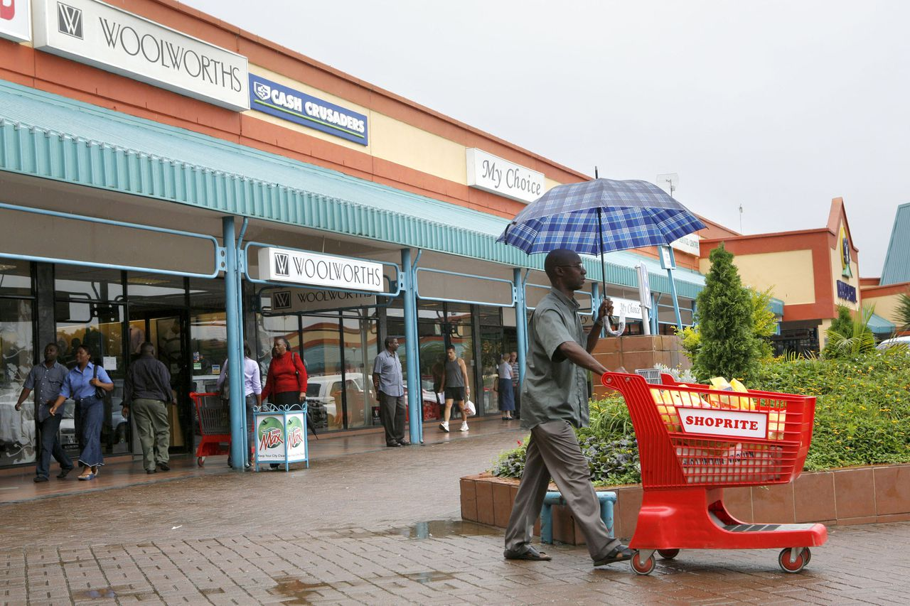 A customer leaves a supermarket owned by Shoprite Holding Ltd, South Africa's biggest retailer in Africa, in the Manda Hill mall in Lusaka, Zambia, on Friday, Feb. 1, 2008. About 68 percent of Zambians currently live below the poverty line, and the average life expectancy is just 38, even as the southern African nation earns record prices for copper, its largest export. Photographer: Jean-Claude Coutausse/Bloomberg News