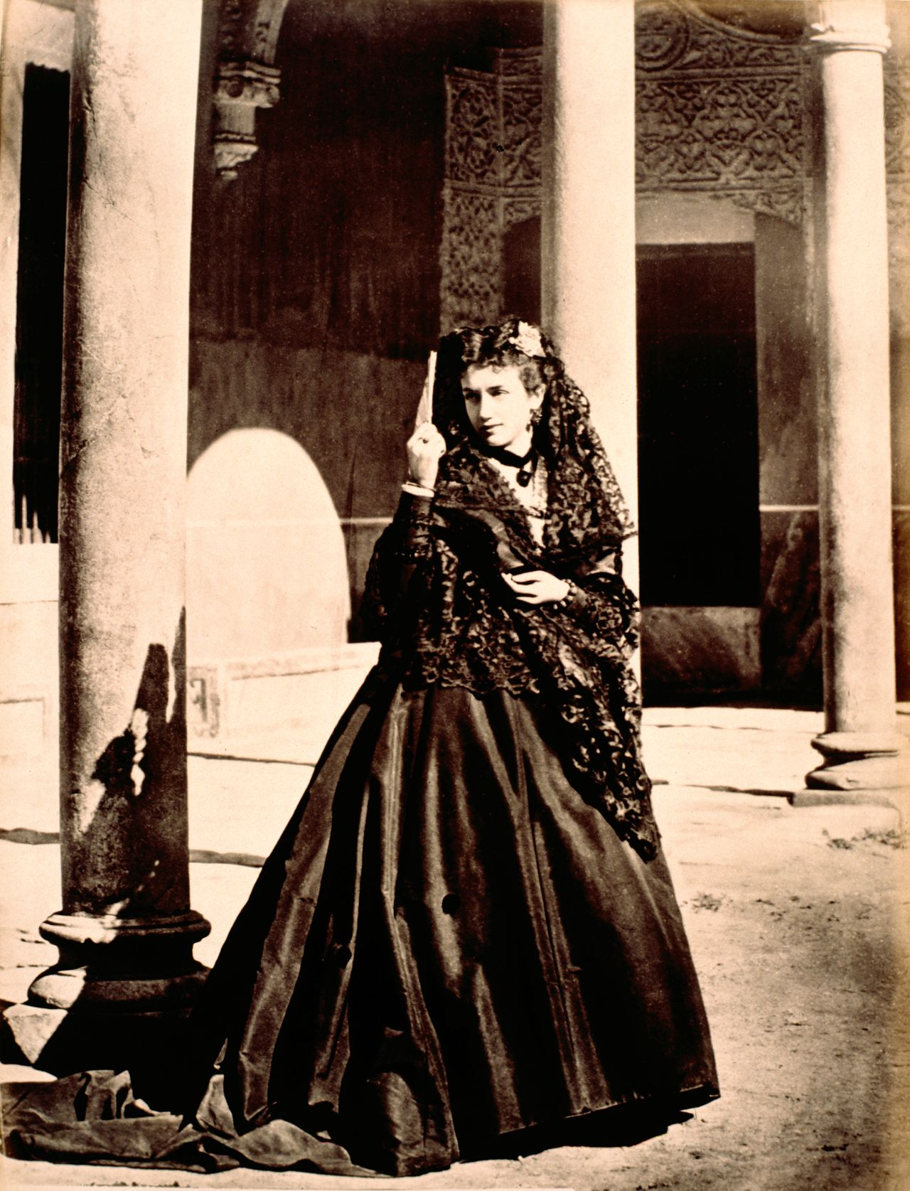 01 Jan 1875, Madrid, Spain --- Woman with a mantilla at Madrid (Spain), ca. 1875. --- Image by © adoc-photos/Corbis