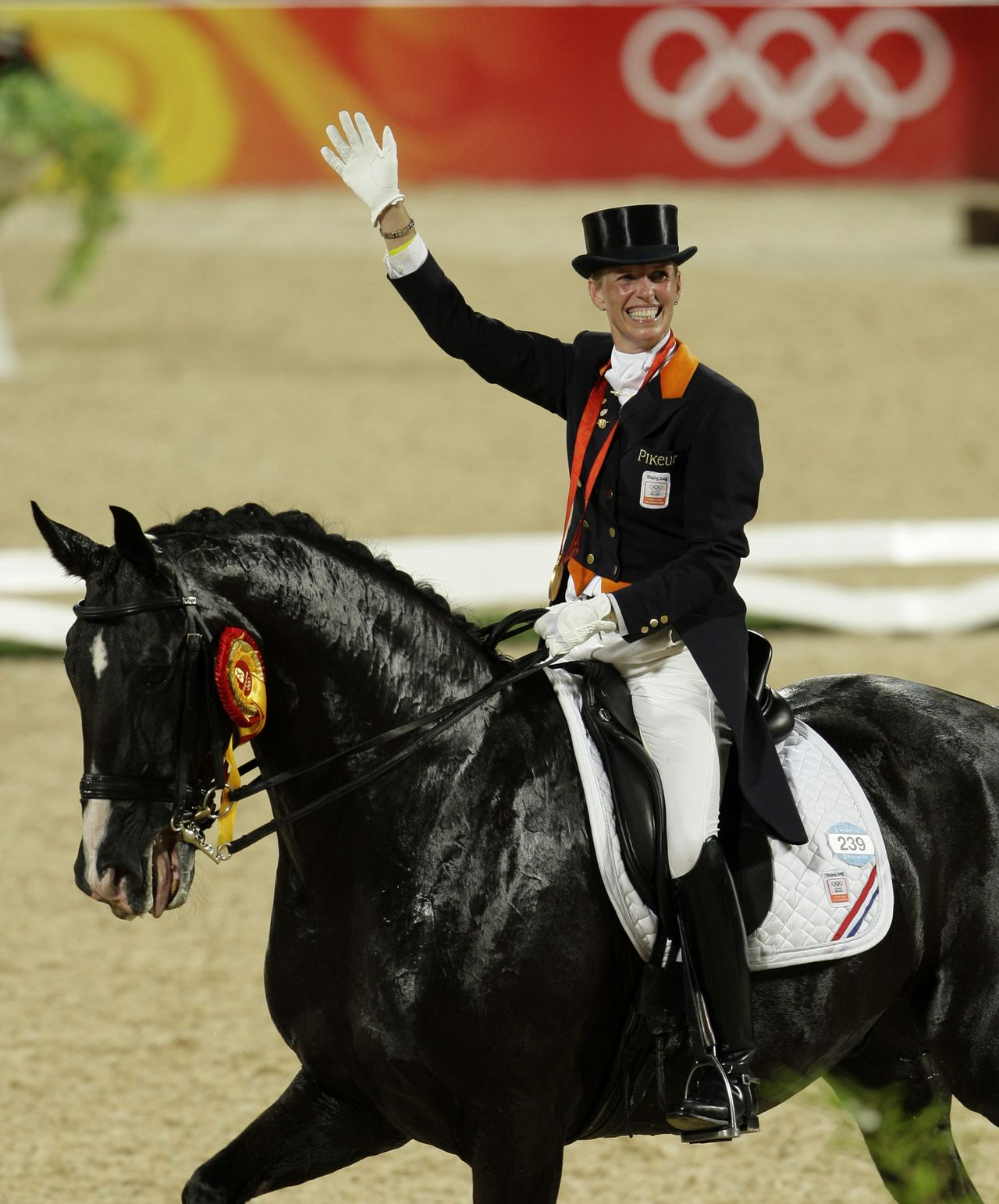 Gold medallist Anky Van Grunsven of the Netherlands celebrates after winning the Equestrian Individual Dressage competition during the Beijing 2008 Olympics in Hong Kong, Tuesday, Aug. 19, 2008. (AP Photo/Kin Cheung)