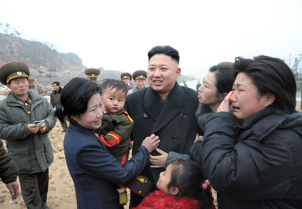 Residents greet North Korean leader Kim Jong-Un (C) during his visit to the Jangjae Islet Defence Detachment and Mu Islet Hero Defence Detachment on the front, near the border with South Korea, southwest of Pyongyang March 7, 2013 in this picture released by the North's official KCNA news agency in Pyongyang March 8, 2013. REUTERS/KCNA (NORTH KOREA - Tags: POLITICS MILITARY) ATTENTION EDITORS - THIS PICTURE WAS PROVIDED BY A THIRD PARTY. REUTERS IS UNABLE TO INDEPENDENTLY VERIFY THE AUTHENTICITY, CONTENT, LOCATION OR DATE OF THIS IMAGE. THIS PICTURE IS DISTRIBUTED EXACTLY AS RECEIVED BY REUTERS, AS A SERVICE TO CLIENTS. QUALITY FROM SOURCE. NO THIRD PARTY SALES. NOT FOR USE BY REUTERS THIRD PARTY DISTRIBUTORS