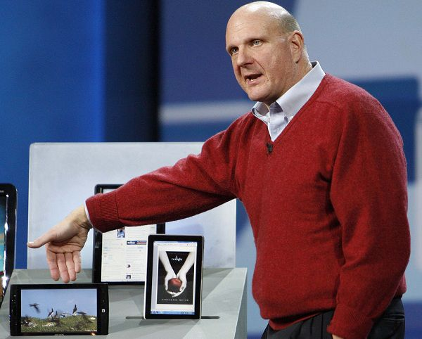 Microsoft Corp Chief Executive Steve Ballmer shows Slate PCs (from L-R) Archos, Pegatron and Hewlett-Packard during his keynote speech before the 2010 International Consumer Electronics Show (CES) in Las Vegas, in this January 6, 2010 file photo. Microsoft's stock has drifted lower, and is now down 16 percent for the year, despite a surge in tech stocks that has pushed the Nasdaq up 10 percent in the same time. To match Special Report MICROSOFT/REUTERS/Mario Anzuoni/Files (UNITED STATES - Tags: BUSINESS SCI TECH)