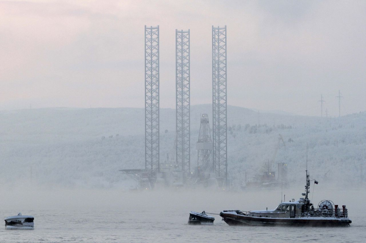 """The """"Kolskaya"""" oil drilling rig is pictured in the Kola Bay near Russia's northern seaport of Murmansk in this November 27, 2010 file photo. The oil drilling rig with 67 crew on board capsized and sank off the Russian Far East island of Sakhalin when it ran into a storm while being towed, and 51 of the crew were unaccounted for, Russian news agencies reported on December 18, 2011. REUTERS/Andrei Pronin/Files (RUSSIA - Tags: DISASTER TRANSPORT ENERGY)"""