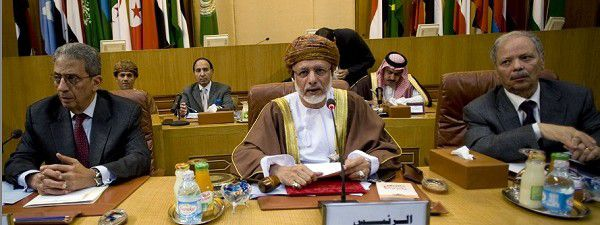 """From left, Arab League chief Amr Moussa, Oman's Foreign Minister Yousuf bin Alawi and the Arab League's undersecretary general Ahmed bin Helli attend the Arab League emergency meeting in Cairo, Egypt, Saturday, March 12, 2011. Arab nations debated whether to call for a Western no-fly zone to protect the rebels _ deciding at a closed emergency Arab League meeting in Cairo whether to issue the endorsement that the U.S. and European nations say they need before acting. The Arabic sign at centre reads:"""" President."""" (AP Photo/Grace Kassab)"""