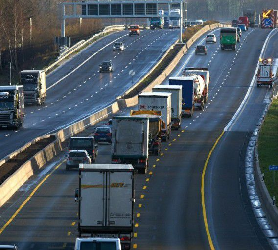 epa03058378 Trucks and cars drive on the the A2 motorway near Boenen, Germany, 13 January 2012. The six-lane expansion of the A2 motorway from Oberhausen leading to the German capital Berlin will be officially opened with a ceremony near Kamen, Germany, on Monday, 16 January. EPA/BERND THISSEN