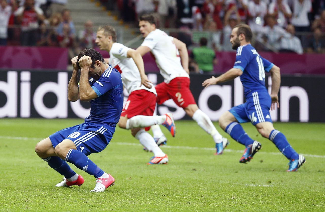 Greece's Giorgos Karagounis reacts after missing a penalty during the Euro 2012 soccer championship Group A match between Poland and Greece in Warsaw, Poland, Friday, June 8, 2012. (AP Photo/Matt Dunham)