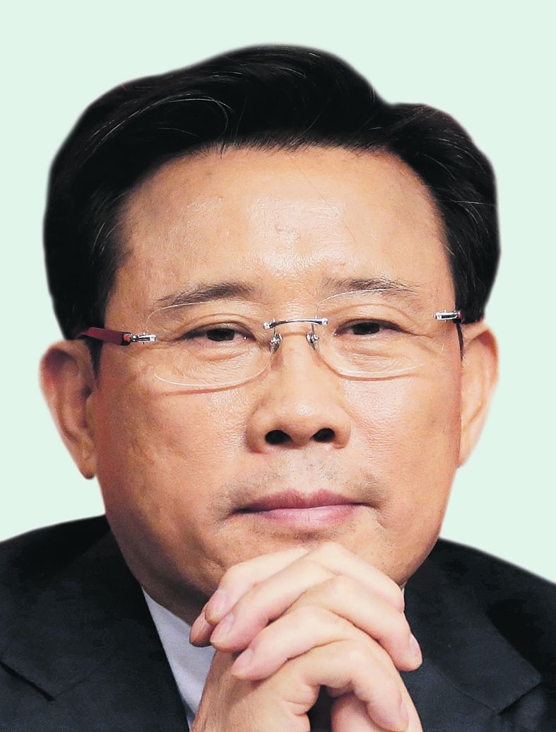 """Liang Wengen, chairman of the board of the SANY Group attends a press conference with the theme of """"implementing innovation strategies to accelerate transformation and development"""" as part of the 18th Communist Party Congress held at the media center in Beijing, China, Saturday, Nov. 10, 2012. (AP Photo/Ng Han Guan)"""