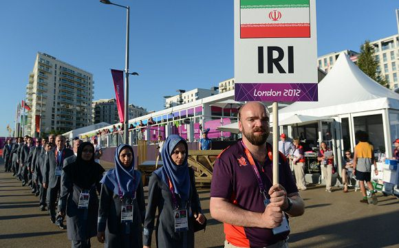 Caption: The Olympic delegation from Iran arrives for the a flag raising ceremony at the Olympic Village in east London on July 23, 2012 four days before the start of the London 2012 Olympic Games. AFP PHOTO / POOL / KHALED DESOUKI