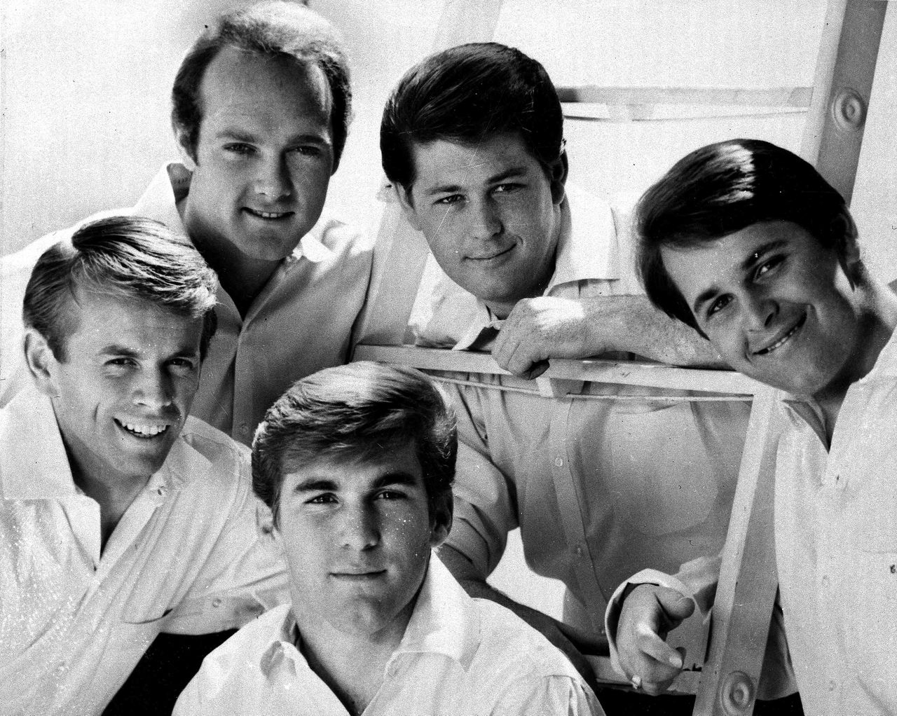 """** FILE **The Beach Boys are shown in this 1966 file photo. From left are Al Jardine, Mike Love, Dennis Wilson, Brian Wilson and Carl Wilson. Classics such as the Beach Boy's """"Good Vibrations"""" and """"Summer Nights"""" from Grease are among the best-loved songs of the summer. While songs that define summer have been as varied as the artists who've performed them, they all share a common thread: They make you feel good, like the last day of school. (AP Photo/FILE)"""