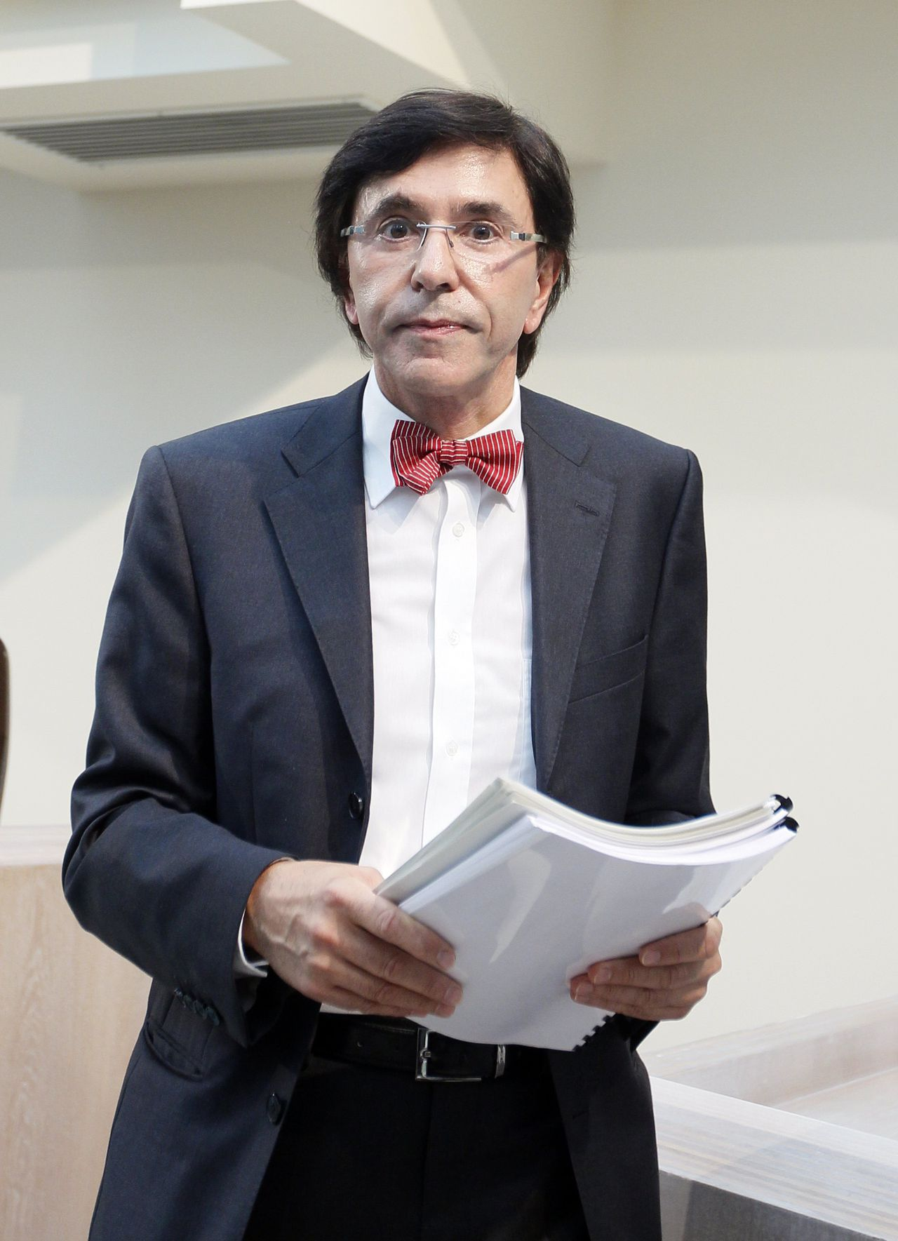 Belgian French-speaking Socialist Party (PS) President Elio Di Rupo leaves a news conference after delivering his final report to Belgian King Albert II in Brussels July 4, 2011. King Albert asked Di Rupo to try to form a government following elections on June 13, 2010, the latest attempt to break 12 months of political stalemate in the linguistically divided country. REUTERS/Yves Herman (BELGIUM - Tags: POLITICS)