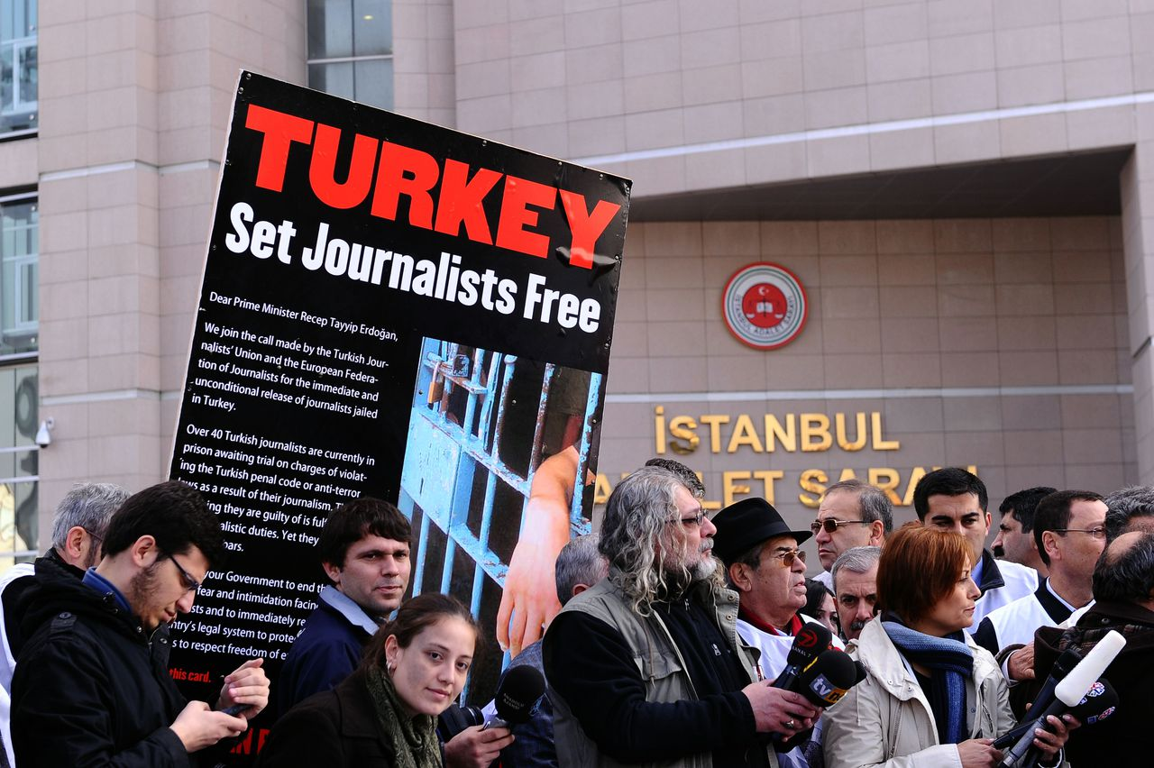 Journalists and human right activists protest in front of the courthouse in Istanbul during the trial of two prominent Turkish journalists Ahmet Sik and Nedim Sener on November 22, 2011. The two journalists charged with aiding a shadowy group aiming to topple the Islamist-rooted government went on trial on November 22. The journalists' arrest sparked widespread concerns about freedom of expression in Turkey, which was also underscored in a report by the European Commission last month on the status of Ankara's EU membership bid. AFP PHOTO / MUSTAFA OZER