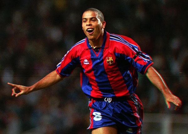 FILE - In this Sept. 12, 1996, file photo, F.C. Barcelona's Brazilian striker Ronaldo celebrates after scoring a goal during a Cup Winner's Cup 1st. round 1st leg soccer match against AEK Larnica of Cyprus in Bracelona, Spain. Ronaldo says on Monday, Feb. 14, 2011, he is retiring from soccer because he can't stay fit anymore, ending a stellar 18-year career in which he thrived with Brazil and some of Europe's top clubs. (AP Photo/Denis Doyle)