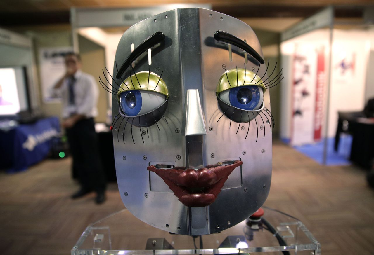 A humanoid robot face is displayed at a stand during the International Conference on Humanoid Robots in Madrid November 19, 2014. REUTERS/Andrea Comas (SPAIN - Tags: SCIENCE TECHNOLOGY)