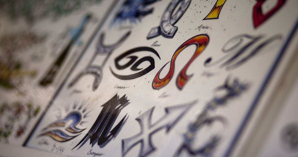 Flash art of the Zodiac symbols line the walls of Atomic Tattoos Friday, Jan. 14, 2011, in Milwaukee. A Minneapolis astronomy professor said Friday that he's stunned by the attention he's getting for suggesting the signs of the zodiac are all wrong. (AP Photo/Darren Hauck)