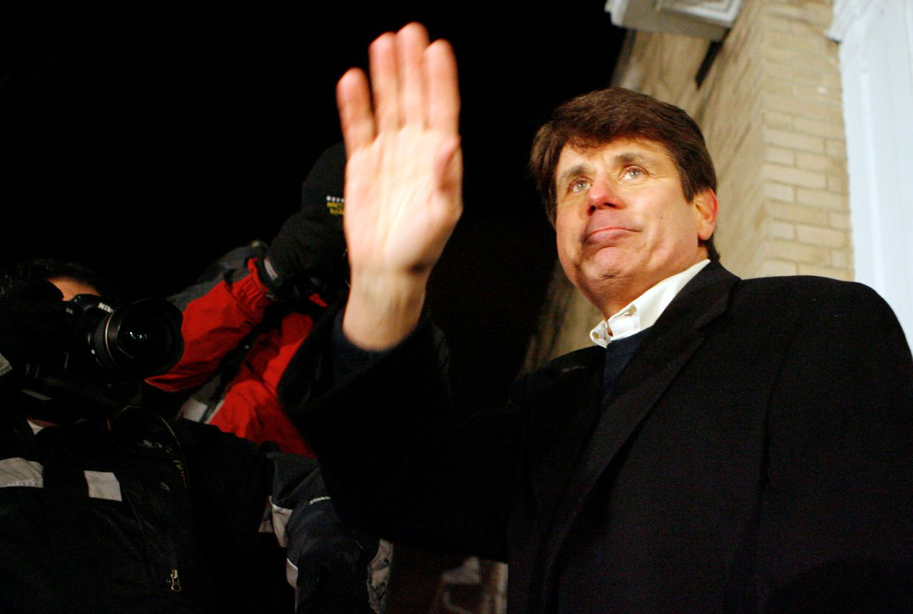 Former Illinois Gov. Rod Blagojevich waves to his supporters after talking to the media outside of his Chicago home, Thursday, Jan. 29, 2009. Blagojevich was thrown out of office Thursday without a single lawmaker rising in his defense, ending a nearly two-month crisis that erupted with his arrest on charges he tried to sell Barack Obama's vacant Senate seat. Blagojevich becomes the first U.S. governor in more than 20 years to be removed by impeachment. (AP Photo/Nam Y. Huh)