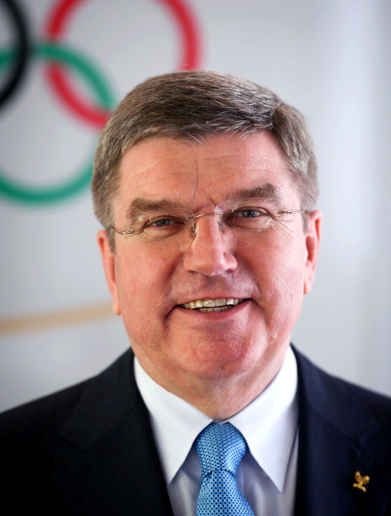 Thomas Bach, president of the German National Olympic Committee (Deutscher Olympischer Sportbund, DOSB) and vice-president of the International Olympic Committee (IOC), poses in front of the Olympic rings prior to a press conference in Frankfurt am Main, western Germany, on May 9, 2013. Bach will run for the office of the IOC's president. AFP PHOTO / FRANK RUMPENHORST / GERMANY OUT