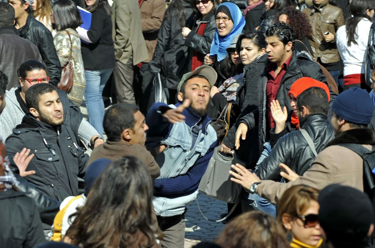 """Islamist students attack students of the Bourguiba Language Institute in the El Khadra neighbourhood, a Salafist bastion, of the capital Tunis, as they try to prevent the filming of current Internet craze the """"Harlem Shake"""" on February 27, 2013. Salafist Muslims caused a fight when they tried to prevent the filming of the global online buzz, but the Islamists eventually withdrew and the students were able to film their production. AFP PHOTO / FETHI BELAID"""