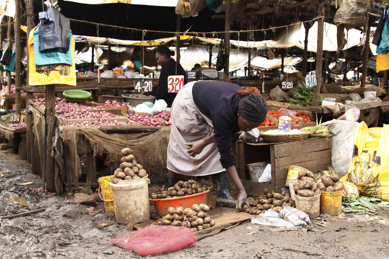 A vendor waits for customers at a vegetable market, Tuesday, May 15, 2012 in the Kibera slum in Nairobi, Kenya. According to a U.N. African Development Report, nearly 218 million people on the African continent are undernourished and 55 million children are malnourished, a figure that is projected to rise. The report says food security can be achieved by several means, including boosting agricultural productivity and creating resilience against natural disasters. Tegegnework Gettu, an assistant secretary-general and regional director for the UNDP bureau in Africa, said chronic food security in sub-Saharan Africa stems from decades of poor governance. (AP Photo/Khalil Senosi)