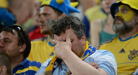 Caption: A fan of Ukraine's national football team reacts during of the Euro 2012 championships football match Ukraine vs France on June 15, 2012 at the Donbass Arena in Donetsk. AFP PHOTO/ FRANCK FIFE