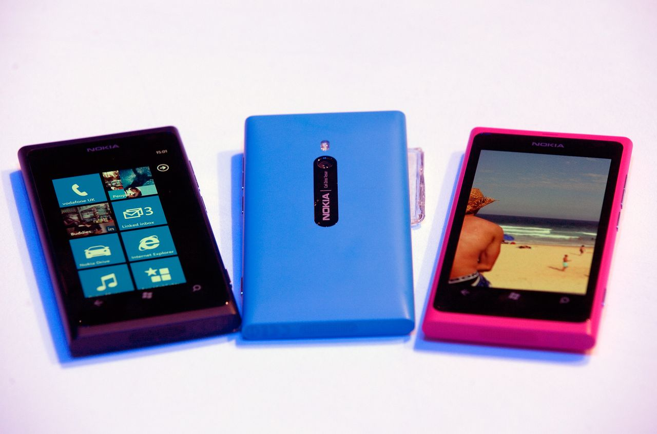 Multicoloured Nokia Lumia 800 smartphones are seen on display during their launch at the Nokia World event in London, U.K., on Wednesday, Oct. 26, 2011. Nokia Oyj, the Finnish handset maker seeking to revive its lineup of smartphones in the race against Apple Inc., introduced its first handsets powered by Microsoft Corp.'s Windows Phone software. Photographer: Simon Dawson/Bloomberg